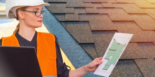 contractor reading printed roof measurement